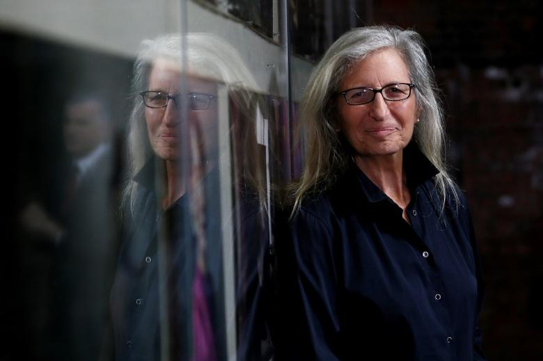 U.S. photographer Annie Leibovitz is reflected in glass during a press preview of her exhibition 'WOMEN: New Portraits' at Wapping Hydraulic Power Station in London, Britain January 13, 2016. REUTERS/Stefan Wermuth/File Photo