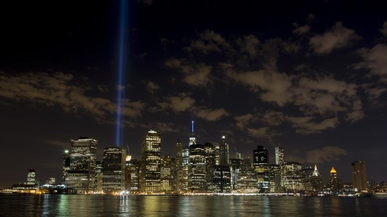 The Tribute in Light installation is illuminated over lower Manhattan as seen from Brooklyn Bridge Park in the Brooklyn borough in New York September 11, 2015. The Tribute in Light is an annually lit feature commemorating the 9/11 attacks. Picture taken with a long exposure. REUTERS/Brendan McDermid -