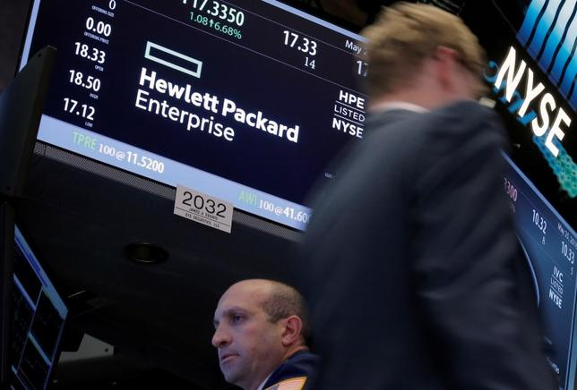 A trader passes by the post where Hewlett Packard Enterprise Co., is traded on the floor of the New York Stock Exchange (NYSE) in New York City, U.S., May 25, 2016.  REUTERS/Brendan McDermid