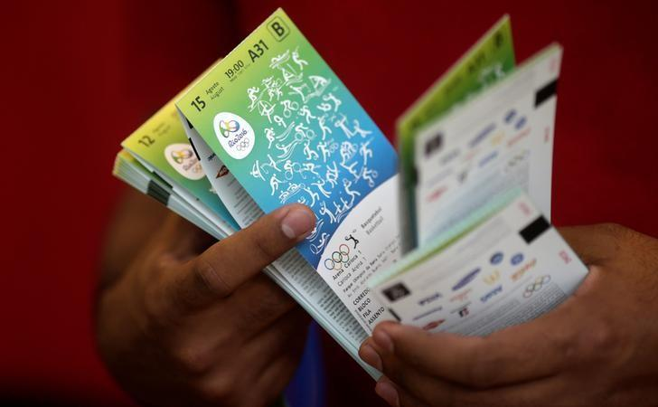 A sport fan shows his tickets after buying them at the 2016 Rio Olympics ticket office in Rio de Janeiro Brazil, June 20, 2016. REUTERS/Ricardo Moraes
