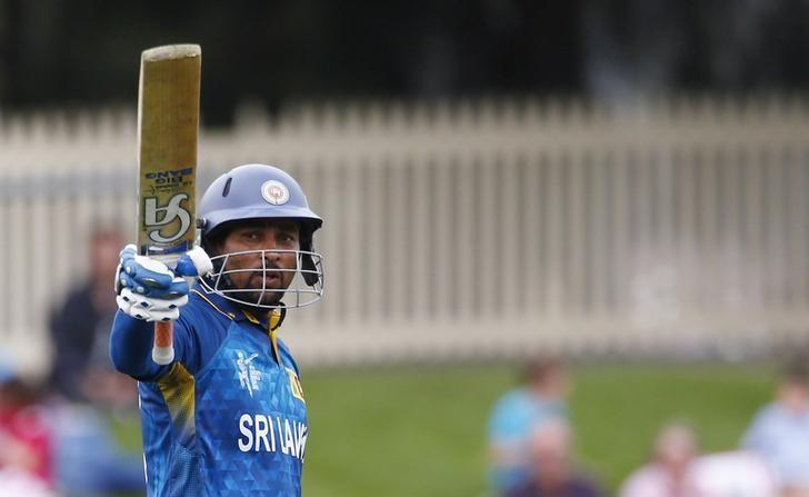 Sri Lankan batsman Tillakaratne Dilshan acknowledges his century during the Cricket World Cup match against Scotland in Hobart March 11, 2015. REUTERS/David Gray/Files