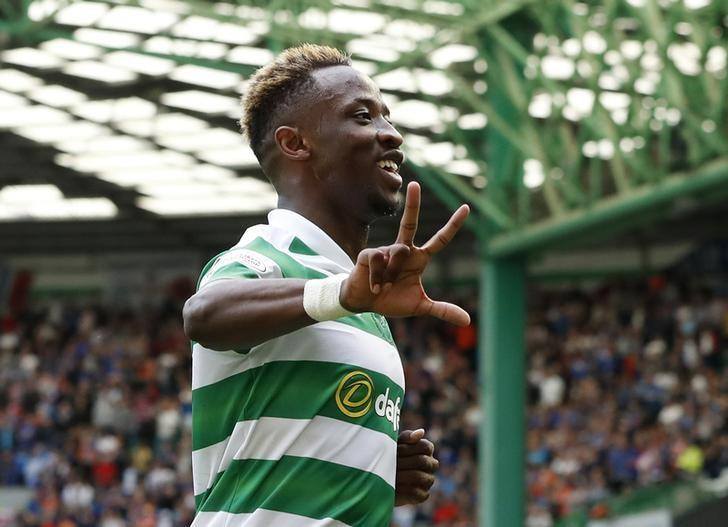 Britain Soccer Football - Celtic v Rangers - Scottish Premiership - Celtic Park - 10/9/16Celtic's Moussa Dembele celebrates scoring their fourth goal and completing his hat-trickReuters / Russell Cheyne/ Livepic