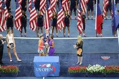 Sep 10, 2016; New York, NY, USA; Angelique Kerber of Germany with the championship trophy after defeating Karolina Pliskova of the Czech Republic in three sets in the championship match on day thirteen of the 2016 U.S. Open tennis tournament at USTA Billie Jean King National Tennis Center. Mandatory Credit: Anthony Gruppuso-USA TODAY Sports