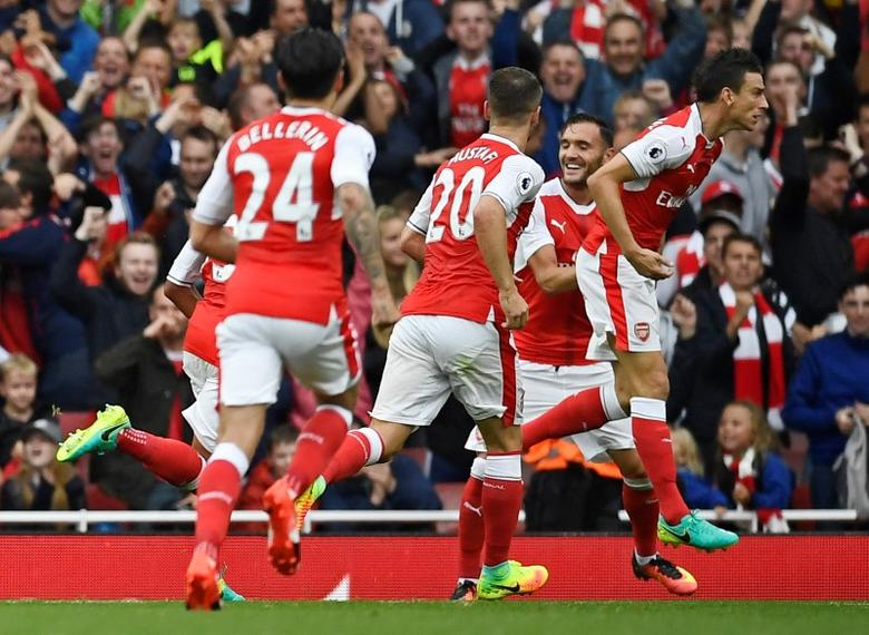 Britain Soccer Football - Arsenal v Southampton - Premier League - Emirates Stadium - 10/9/16Arsenal's Laurent Koscielny celebrates scoring their first goal with team matesReuters / Dylan Martinez