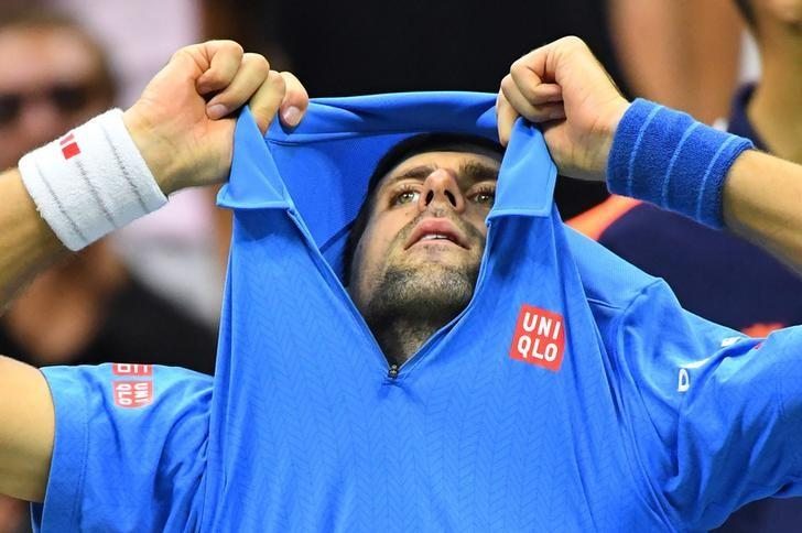 Sept 11, 2016; New York, NY, USA;   Novak Djokovic of Serbia after losing the 3rd set playing Stan Wawrinka of Switzerland in the men's singles final on day fourteen of the 2016 U.S. Open tennis tournament at USTA Billie Jean King National Tennis Center. Mandatory Credit: Robert Deutsch-USA TODAY Sports