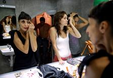 Actors get ready before their performance at Microteatro Por Dinero (Microtheatre for money) in central Madrid, Spain September 2, 2016. Picture taken September 2, 2016. REUTERS/Andrea Comas