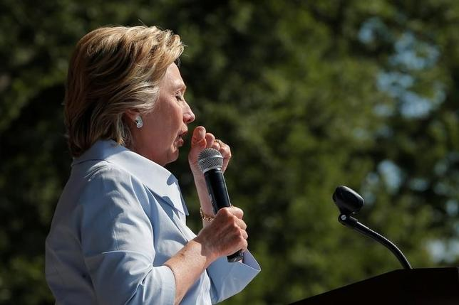 U.S. Democratic presidential candidate Hillary Clinton coughs onstage during a campaign stop at the 11th Congressional District Labor Day Parade and Festival in Cleveland, Ohio, United States September 5, 2016.  REUTERS/Brian Snyder