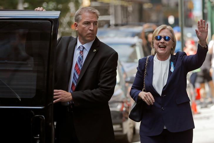 U.S. Democratic presidential candidate Hillary Clinton leaves her daughter Chelsea's home in New York, New York, United States September 11, 2016, after Clinton left ceremonies commemorating the 15th anniversary of the September 11 attacks feeling ''overheated.''  REUTERS/Brian Snyder