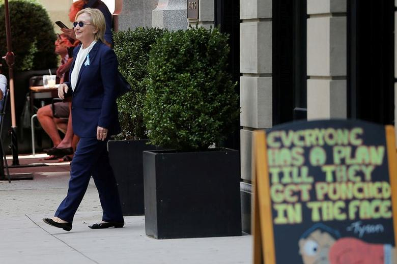 Clinton, 68, was taken to her daughter Chelsea's home in Manhattan, and emerged later wearing sunglasses and telling reporters that she was ''feeling great,'' around two hours after she left the event on a hot and muggy morning.   REUTERS/Brian Snyder