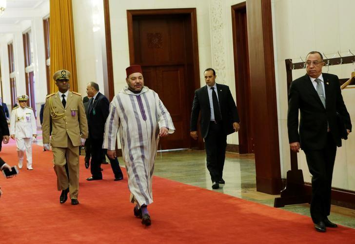 Moroccan King, Mohammed VI (C), arrives at the Great Hall of People for a meeting with China's Premier Li Keqiang (not in picture) in Beijing, China May 12, 2016. REUTERS/Jason Lee/File Photo