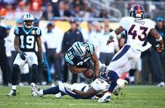 Feb 7, 2016; Santa Clara, CA, USA; Denver Broncos free safety Darian Stewart (26) forces Carolina Panthers fullback Mike Tolbert (35) to fumble in the second quarter in Super Bowl 50 at Levi's Stadium. Mandatory Credit: Mark J. Rebilas-USA TODAY Sports