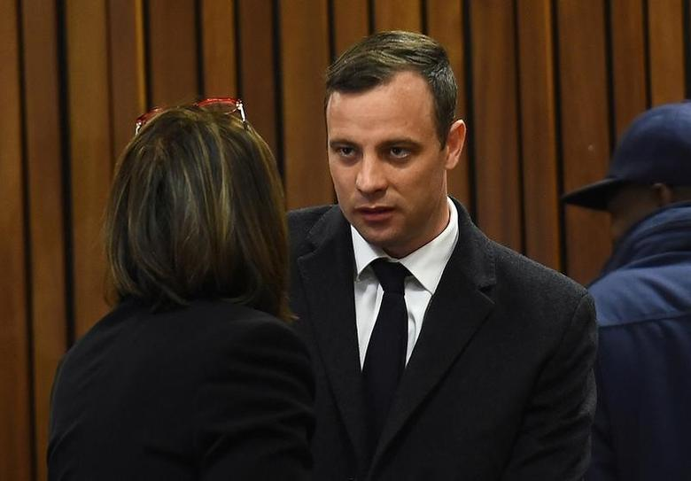 Olympic and Paralympic track star Oscar Pistorius speaks with his legal team ahead of his sentence hearing at the North Gauteng High Court in Pretoria, South Africa, July 6, 2016. REUTERS/Masi Losi/Pool/Files