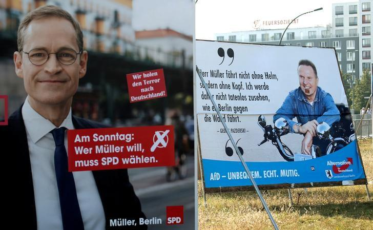 Election posters of top candidate of Social Democratic Party (SPD) and Mayor of Berlin Michael Mueller (L) and top candidate of the anti-immigration party Alternative for Germany (AfD) Georg Pazderski for the upcomming local city elections are pictured in Berlin, Germany, September 14, 2016.    REUTERS/Fabrizio Bensch/File Photo