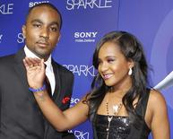 "Bobbi Kristina Brown, daughter of the late singer Whitney Houston, waves while arriving with boyfriend Nick Gordon at the premiere of the new film ""Sparkle"", in Hollywood, California August 16, 2012. REUTERS/Fred Prouser/File Photo"