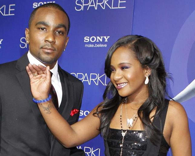Bobbi Kristina Brown, daughter of the late singer Whitney Houston, waves while arriving with boyfriend Nick Gordon at the premiere of the new film ''Sparkle'', in Hollywood, California August 16, 2012. REUTERS/Fred Prouser/File Photo