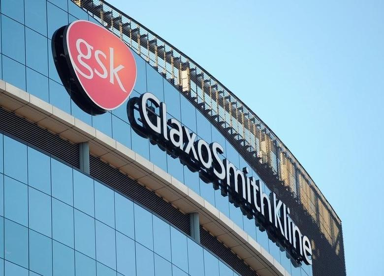A GlaxoSmithKline logo is seen outside one of its buildings in west London, February 6, 2008. REUTERS/Toby Melville/File Photo