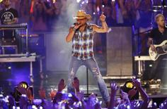 "Musician Jason Aldean performs ""Lights Come On"" during the 2016 CMT Music Awards in Nashville, Tennessee U.S. June 8, 2016.  REUTERS/Jamie Gilliam"