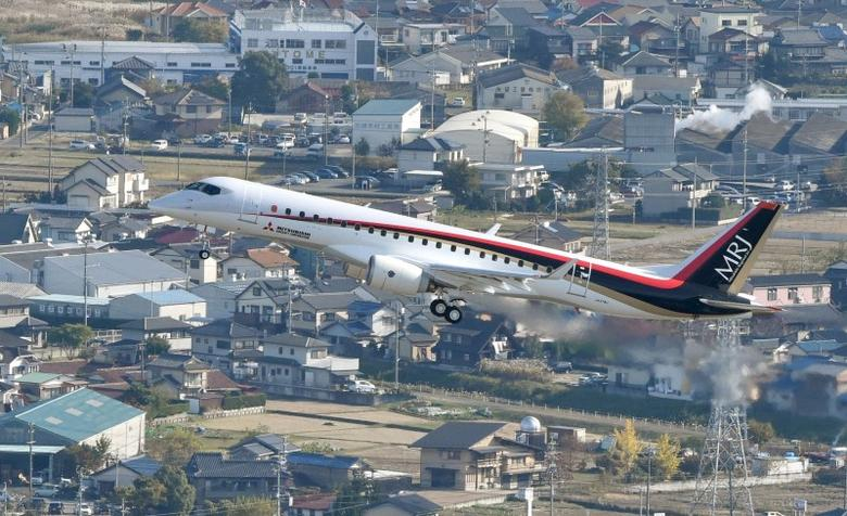 An aerial view shows Mitsubishi Aircraft Corp's Mitsubishi Regional Jet (MRJ) taking off for a test flight at Nagoya Airfield in Toyoyama town, Aichi Prefecture, central Japan, in this photo released by Kyodo November 11, 2015. REUTERS/Kyodo