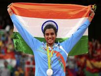 2016 Rio Olympics - Badminton - Women's Singles - Victory Ceremony - Riocentro - Pavilion 4 - Rio de Janeiro, Brazil - 19/08/2016. Silver medallist P.V. Sindhu (IND) of India poses with an Indian national flag. REUTERS/Marcelo del Pozo