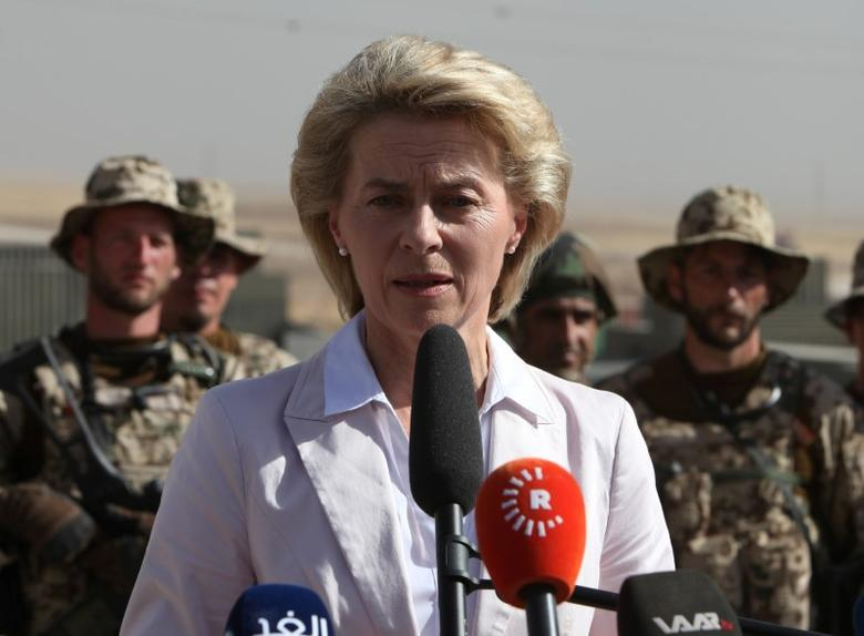 German Defence Minister Ursula von der Leyen speaks to Kurdish Peshmerga and German Bundeswehr soldiers during her visit to the educational centre Banslawa near Erbil, Iraq, September 23, 2016. REUTERS/Azad Lashkari