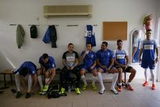 Players from Ariel Municipal Soccer Club, who are affiliated with Israel Football Association, wait in their dressing room ahead of their match against Maccabi HaSharon Netanya at Ariel Municipal Soccer Club's training grounds in the West Bank Jewish settlement of Ariel September 23, 2016. Picture taken September 23, 2016. REUTERS/Amir Cohen