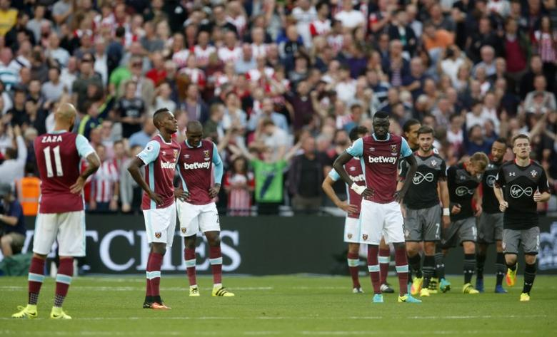 Britain Football Soccer - West Ham United v Southampton - Premier League - London Stadium - 25/9/16West Ham players look dejected after Southampton's James Ward-Prowse scored their third goal Action Images via Reuters / Matthew ChildsLivepic