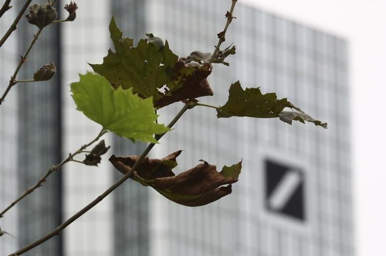 Branches of a tree are pictured in front of the Deutsche Bank headquarters in Frankfurt, Germany, September 30, 2016. REUTERS/Kai Pfaffenbach