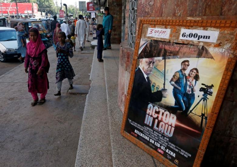 An advertising poster for an Indian film is seen outside a movie theater in Karachi, Pakistan, September 30, 2016. REUTERS/Akhtar Soomro