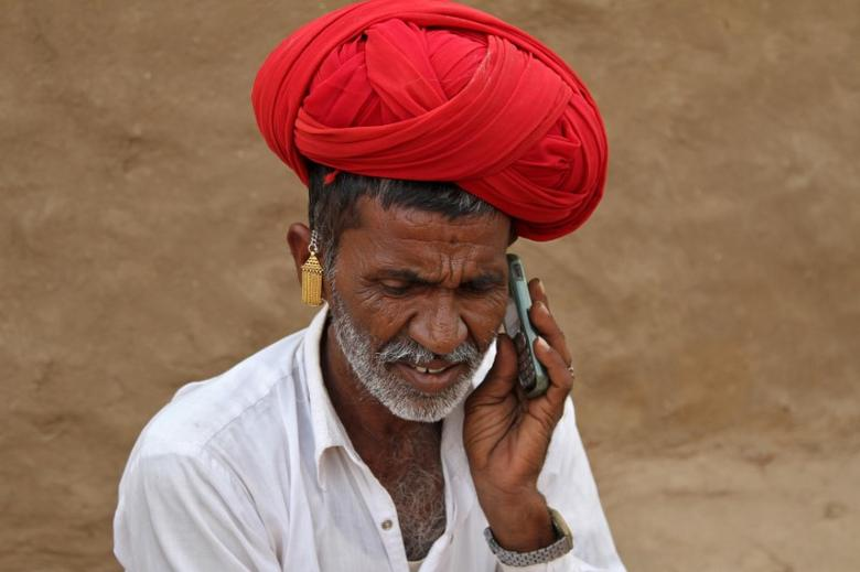 A man talks on his mobile phone in the village of Devmali in the desert state of Rajasthan, India June 14, 2016. REUTERS/Himanshu Sharma