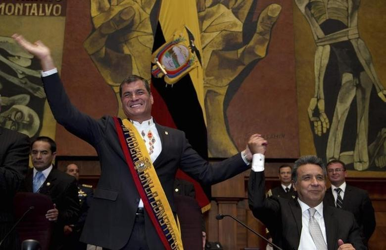 Rafael Correa (L), joined by Lenin Moreno, waves to government officials at the National Assembly during his '2012 Report to the Nation' in Quito August 10, 2012. REUTERS/Guillermo Granja
