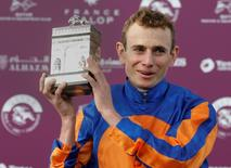 Irish Ryan-Lee Moore on Found celebrates with his trophy after he won the Qatar Prix de l'Arc de Triomphe at the Chantilly racetrack near Paris, France, October 2, 2016. REUTERS/Jacky Naegelen