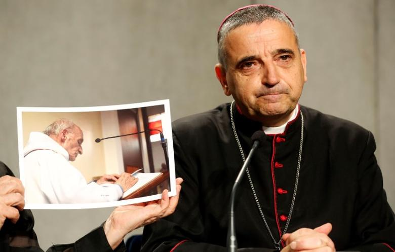 Archbishop of Rouen Dominique Lebrun is seen next to a picture of Father Jacques Hamel, the French priest knifed to death at his altar by Islamist militants in July, during a media conference at the Vatican, September 14, 2016. REUTERS/Stefano Rellandini