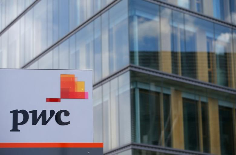 The logo of PricewaterhouseCoopers is seen in front of the local offices building of the company in Luxembourg, April 26, 2016. REUTERS/Vincent Kessler