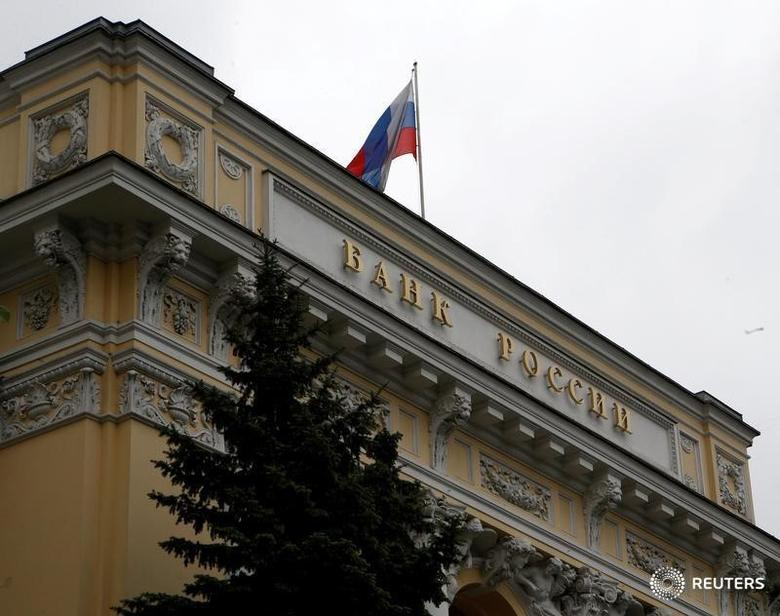 A Russian national flag flies over the Central Bank headquarters in Moscow, Russia, May 17, 2016. REUTERS/Sergei Karpukhin/File Photo