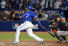 Toronto Blue Jays first baseman Edwin Encarnacion (10) hits a walk off three run home run against Baltimore Orioles to give the Jays a 5-2 win in the American League wild card playoff baseball game at Rogers Centre. Mandatory Credit: Dan Hamilton-USA TODAY Sports