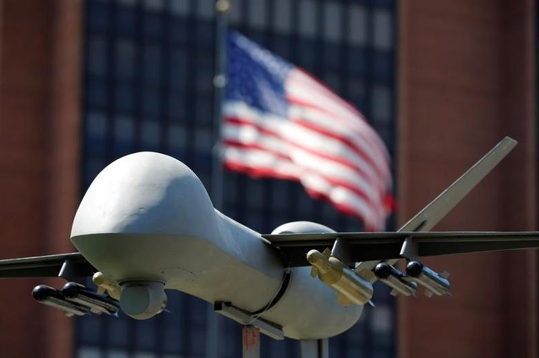 A model of a military drone is seen in front of an U.S. flag as protesters rally against climate change, ahead of the Democratic National Convention, in Philadelphia, Pennsylvania, U.S., July 24, 2016. REUTERS/Dominick Reuter