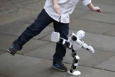 The Alpha 1S Robot is copied by Tristan Robertson-Jeyes, aged five, during a photo-call at the launch of Hamley's predicted top ten toys that will be on children's lists this Christmas, in London, Britain October 6, 2016.  REUTERS/Peter Nicholls