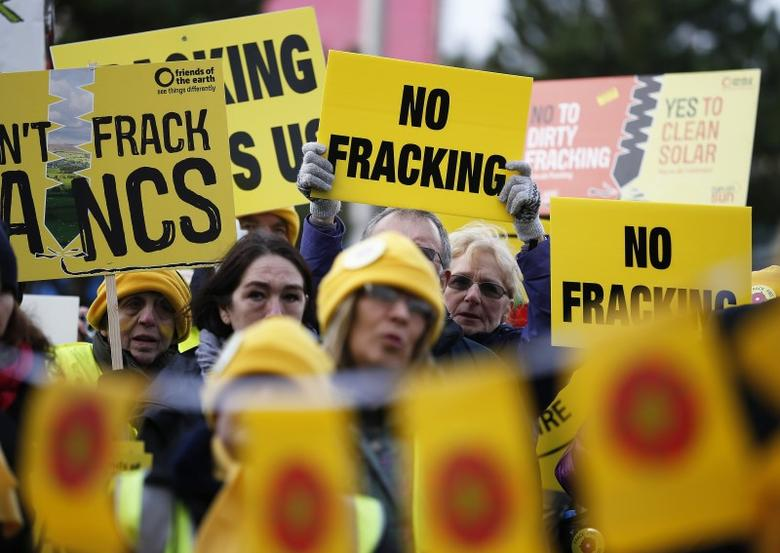 Anti-fracking demonstrators gather outside Blackpool Football Club on the opening day of the public inquiry into Lancashire County Council's decision to refuse permission for fracking at two sites, Blackpool in Britain February 9, 2016. REUTERS/Phil Noble