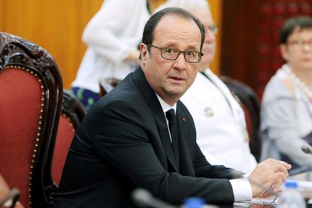 10月6日、フランスのオランド大統領は、欧州連合は離脱を選んだ英国との交渉に当たり厳しい姿勢を貫くべきとの考えを示した。 写真は、ベトナムのグエン・スアン・フック首相との会合に出席した同大統領。ハノイ・ベトナム首相官邸で撮影(2016年 ロイター/Min Hoang)