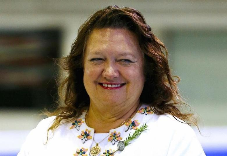 Australian mining heiress and Chairman of Hancock Prospecting group Gina Rinehart prepares to award medals to competitors at the Australian Synchronised Swimming Championships in Sydney, Australia, April 25, 2015.       REUTERS/Jason Reed/File Photo