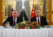 Russian President Vladimir Putin (L) talks during a joint news conference with his Turkish counterpart Tayyip Erdogan following their meeting in Istanbul, Turkey, October 10, 2016. REUTERS/Osman Orsal