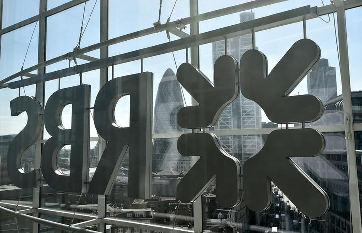 The City of London business district is seen through windows of the Royal Bank of Scotland (RBS) headquarters in London, Britain in this September 10, 2015 file photo. REUTERS/Toby Melville/File Photo