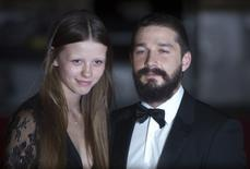 Shia LaBeouf poses with girlfriend Mia Goth. REUTERS/Neil Hall/File Photo