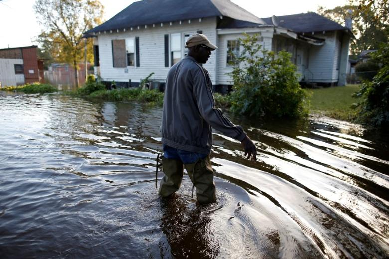 Quincy Crawford of West Mulberry Lane walks through the flood waters to his home after the effects of Hurricane Matthew in Goldsboro, North Carolina, U.S., October 12, 2016. REUTERS/Randall Hill