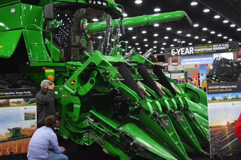 People look at Deere equipment as they attend National Farm Machinery show in Louisville, Kentucky, February 11, 2016. REUTERS/Meredith Davis