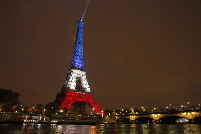 The Eiffel Tower is lit with the blue, white and red colours of the French flag in Paris, France, <a href=