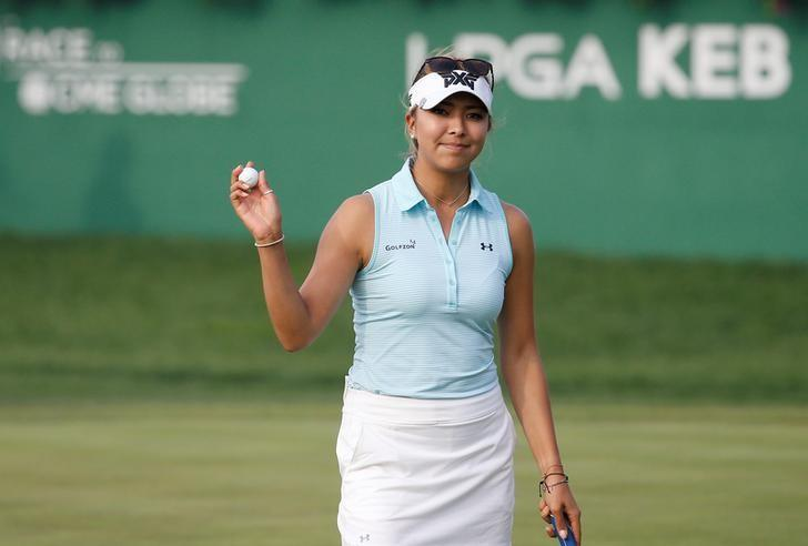 Golf - LPGA KEB Hana Bank Championship - Third Round - Incheon, South Korea - 15/10/16.  Alison Lee of U.S. waves to her fans on the eighteenth green. REUTERS/Kim Hong-Ji