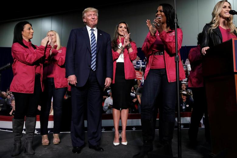 Republican U.S. presidential nominee Donald Trump stands with female supporters on stage at a campaign rally in Charlotte, North Carolina, U.S., October 14, 2016.   REUTERS/Mike Segar