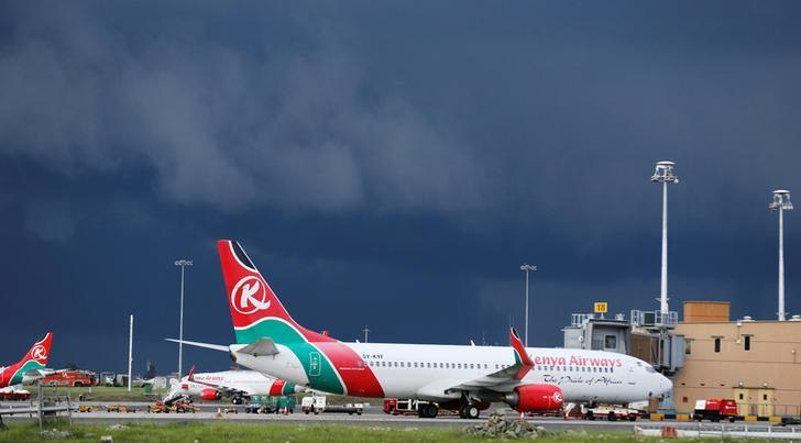 Kenya Airways planes are seen parked at the Jomo Kenyatta International airport near Kenya's capital Nairobi, April 28, 2016. REUTERS/Thomas Mukoya/File Photo