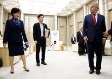IOC President Thomas Bach (R) meets Tokyo Governor Yuriko Koike at Tokyo Metropolitan Government Building in Tokyo, Japan, October 18, 2016.   REUTERS/Kim Kyung-Hoon